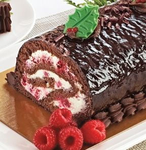 FESTIVE YULE LOG. • Hand-made and hand-rolled   • Made with real cream and white chocolate  • Serve as a dessert for guests or family during the holidays. - M & M Meat Shops.