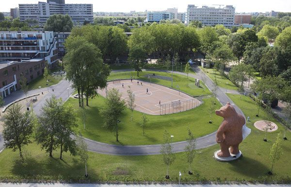 Steelman by Florentijn Hofman Amsterdam (NL) 2011 6 x 5 x 11 meters Concrete and Keim coating.  The Steelman is a 11 meter high concrete sculpture which has the appearance of a bear with pillow under it's arms standing on a elipse shape stairs.