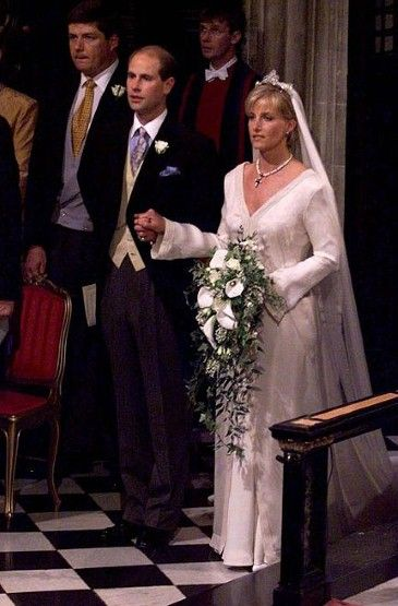 Prince Edward, the youngest son of Queen Elizabeth II and his bride Sophie Rhys-Jones, walk down the aisle at the end of their wedding June 19, in St George's Chapel, Windsor Castle. Sophie Rhys-Jones, now the Countess of Wessex, wore a gown by Samantha Shaw at her wedding to the Earl of Wessex, Prince Edward in 1999.