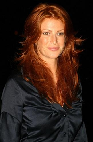 "Angie EverharT was reportedly Glamour magazine's first red-haired cover girl. She has described her color as ""a shiny copper penny in the light with an old copper penny mixed in."""