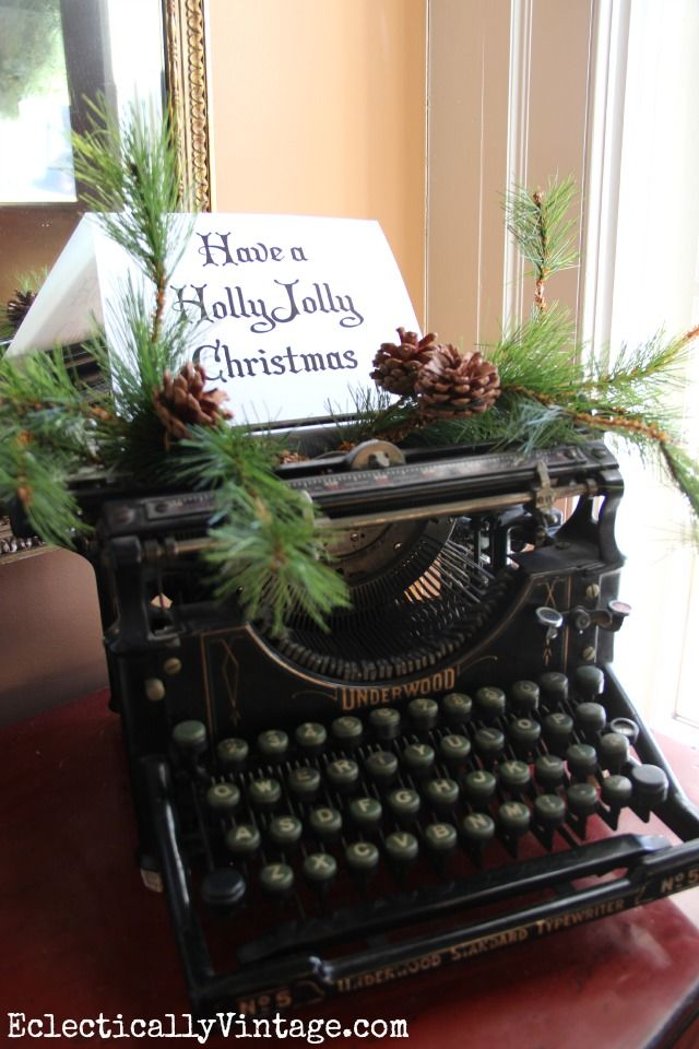 Have a Holly Jolly Christmas - vintage Underwood typewriter is a fun way to decorate - you have to see this creative Christmas house tour! eclecticallyvintage.com