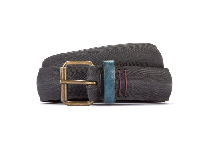#2668 - Black belt from a spare race bicycle tyre, entirely handcrafted, iron branded and numbered. Dark blue, leather belt loop. Strap folded up and stitched up with cotton colored strings.