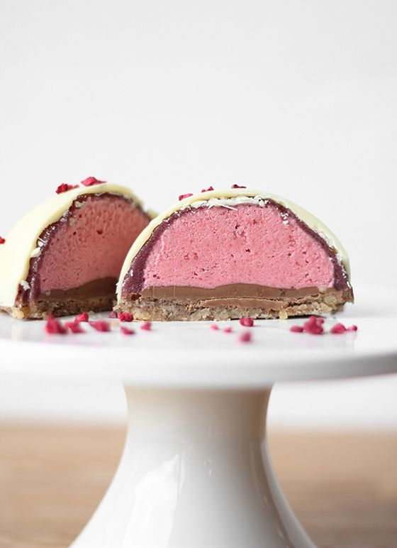 White chocolate marzipan dome spheres with strawberry mousse and nougat