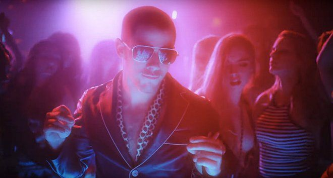 "Watch Nick Jonas Deal With 'Champagne Problems' Check out the electric video Nick Jonas is making his fans happy again with yet another music video, this time for ""Champagne Problems,"" off his latest album Last Year Was Complicated. It is the sixth song from the record to receive the video treatment after ""Close,"" ""Chainsaw,"" ""Bacon,"" ""Under You"" and ""Voodoo."""