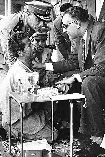Jamal Abdel Nasser (seated on the right), giving a job to a homeless man who interrupted his meeting. Beloved by many, feared by his enemies and admired by all who knew his life.