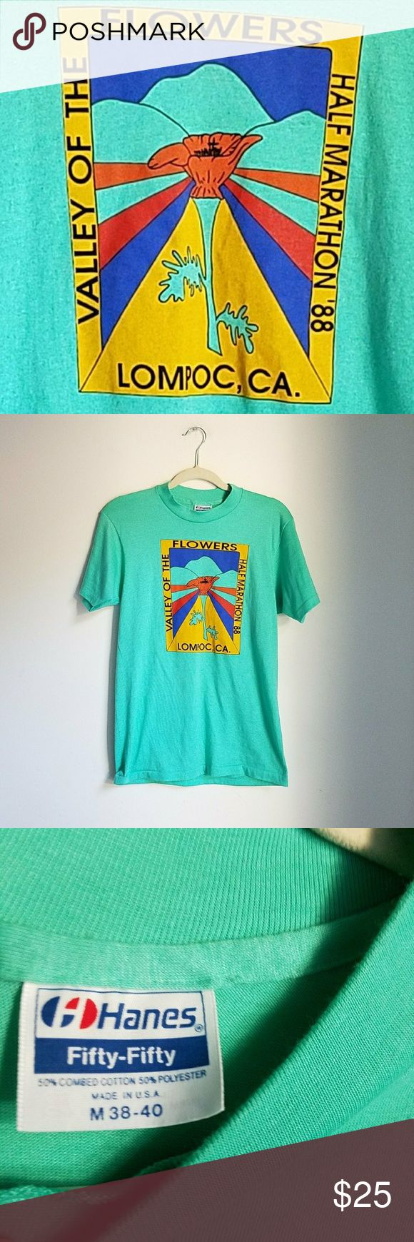 Vtg '88 Valley of the Flowers retro tee Vintage 80's Valley of the Flowers Lompoc California emerald green tee. Size M.   Super soft and easy to wear. Such retro vibes and perfect comfy fit.   It looks like new condition.    ● 20% off bundles.   Vintage 80s eighties tshirt marathon  lompoc califonia flower child retro colorful hippie indie urban street wear free alternative apparel notsopopularhobbit Vintage Tops