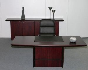 The photo shows the following models in rosewood: 6502 desk 2 x 6020 base cabinets 6515 top board 8497W executive chair w/leather 114 coffee