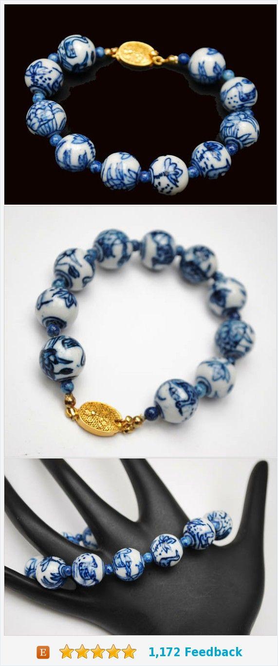 Blue White Porcelain bead bracelet - Asian - gold clasp - painted Birds flowers https://www.etsy.com/serendipitytreasure/listing/526769133/blue-white-porcelain-bead-bracelet-asian?ref=listing_published_alert