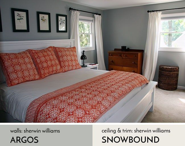 We decorated our bedroom with a gray, white, and orange theme using Sherwin Williams Argos and Snowbound. We built the white farmhouse bed from an Ana White design. The curtains are from Ikea.