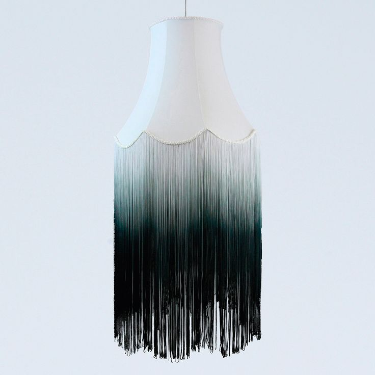 Fade fringe lampshade. Maybe spray paint a design or bird or something on ombre fringe.