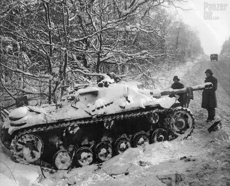 https://flic.kr/p/FpqAWD | Sturmgeschütz III für Sturmkanone 40 (L/48) (Sd.Kfz. 142/1) Ausf. G | Abandoned StuG pushed out of the road during the operation Wach am Rhein, late December 1944.