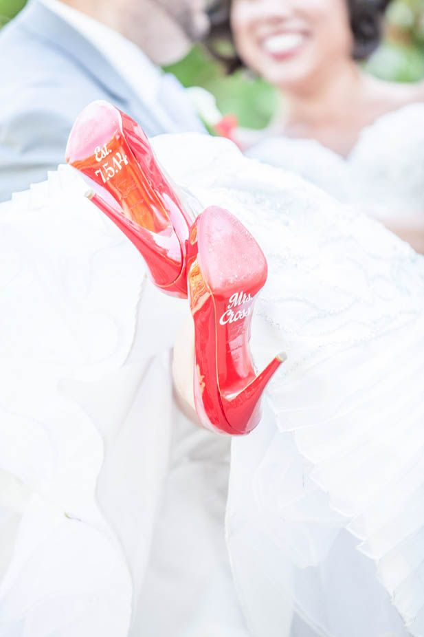 Love the custom decals on the bottom of this bride's heels