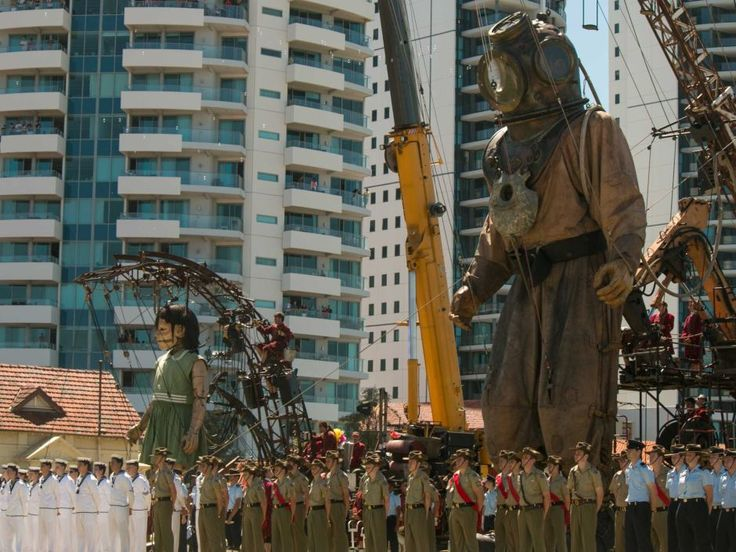 The Giants watch the Anzac service and the lighting of the ANZAC Flame at Langley Park.