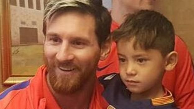 An Afghan boy who became an online hit after wearing a homemade shirt bearing Lionel Messi's number 10 meets his hero.