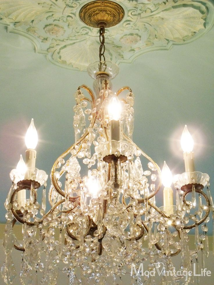 pretty crystal chandelier and lovely ceiling art
