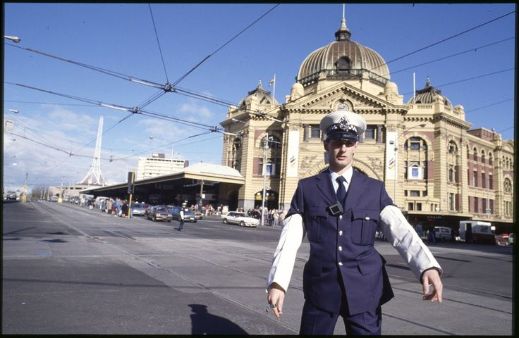 Traffic Police cnr Flinders and Swanston St Melbourne by Rennie Ellis