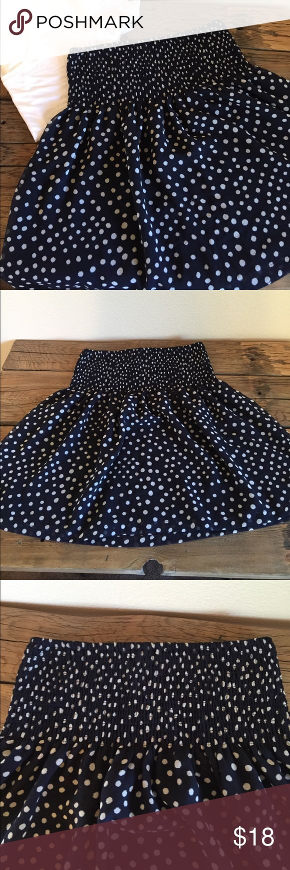 """Polka Dot Smocked Waist Loft Skirt This fun skirt is perfect for hot temperatures! With the wide smocked waistband, you can wear it lower for a day at the office, or pulled up higher with a top tucked in! Looks cute in pattern mixed outfits, with heels or strappy sandals, with a white tee or chambray button up, the list goes on. Size 8, fits TTS. 14.5"""" waistband flat,   18"""" long. LOFT Skirts"""