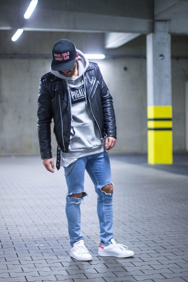 Shop this look on Lookastic:  https://lookastic.com/men/looks/biker-jacket-hoodie-skinny-jeans-low-top-sneakers-baseball-cap/13146  — Black Print Baseball Cap  — Grey Print Hoodie  — Black Leather Biker Jacket  — Light Blue Ripped Skinny Jeans  — White Low Top Sneakers