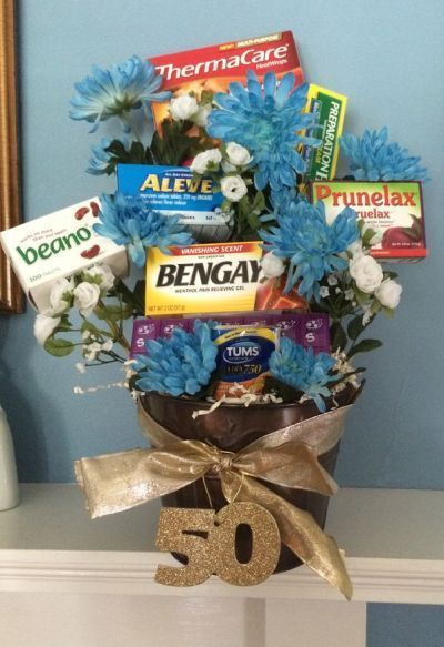 Old age remedies tucked into a flower arrangement is a comforting idea for a 50 birthday.  See more 50th birthday gag gifts and party ideas at www.one-stop-party-ideas.com