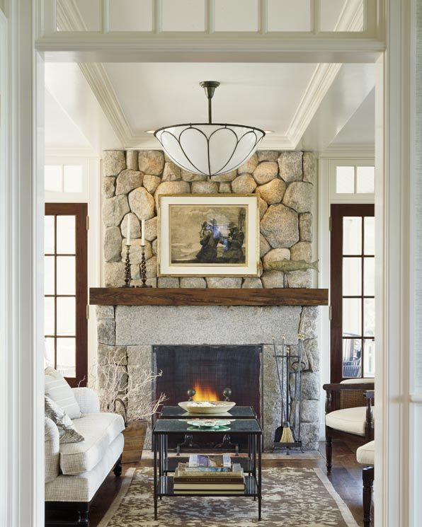 Beach house:  other side is screened porch w/fireplace; love the stone fireplace w/simple mantle and stone surround; french doors w/transoms; neutral palette; ceiling light (Tiffany?); coffered ceiling; transomed doorway. // These Rocks 4 the Hearth around the Base of the Cherry Wood Fireplace @Cathy Hohmeyer : )