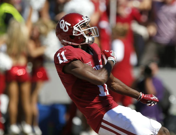 Oklahoma's Dede Westbrook (11) celebrates after scoring a touchdown during the Red River Showdown college football game between the University of Oklahoma Sooners (OU) and the Texas Longhorns (UT) at Cotton Bowl Stadium in Dallas, Saturday, Oct. 8, 2016. Photo by Bryan Terry, The Oklahoman