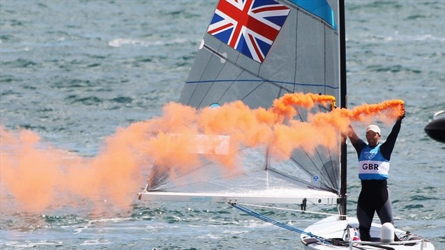 Ben Ainslie of TeamGB celebrates overall victory after competing in the Men's Finn and becoming the greatest ever Olympic sailor