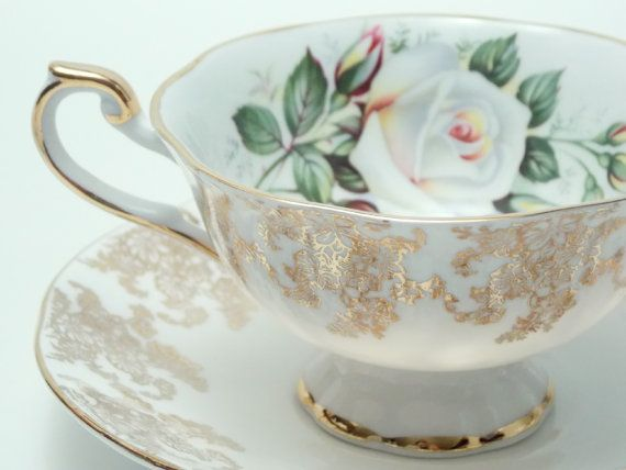 Queen's Rosina Large White and Small Yellow Roses Gold Chintz Tea Cup and Saucer Vintage Fine Bone China Made in England