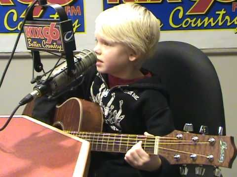 "Carson Lueders, age 7, sing his original song  ""My Dog Buddy"", on KIX96 ..."