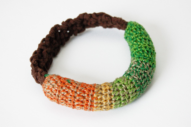 Atelier 44  18.12€  Pixel Bracelet    Made of: brown faux suede cord, crocheted cotton thread insertion.  Circumference: 29 cm; diameter - 7 cm.
