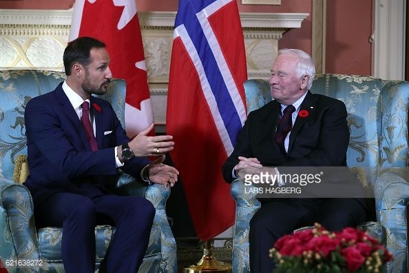 Crown Prince Haakon of Norway gestures while speaking to Governor General of Canada David Johnston during the royal couple's visit in Ottawa Ontario...