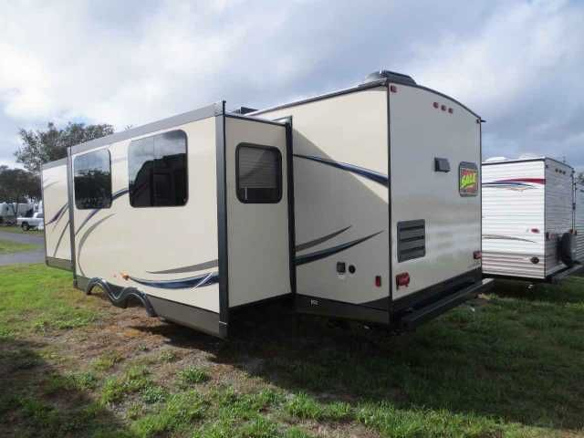2015 New Gulf Stream Gulf Breeze Champagne 30RKS Travel Trailer in Florida FL.Recreational Vehicle, rv, Brand new 2015 Gulf Stream Gulf Breeze Champagne 30RKS. Unit features a rear kitchen floor plan. Options include:-solid surface countertops-15,000 BTU A/C-interior and exterior TV mounts-awning light with switch-glass shower door-Lane hide-a-bed sofa-plush dinette-2 rocker recliners-8 CU. FT. refrigerator-stainless steel appliances-3 burner range cover-frameless bonded windows-electric…