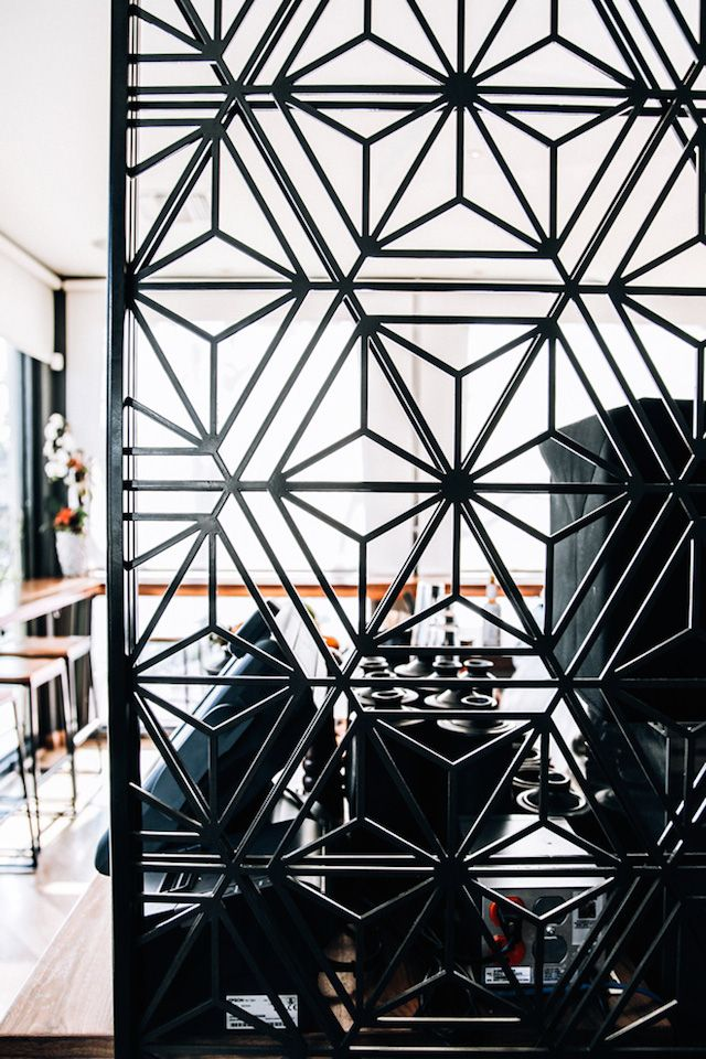 (Russell) I love this room divider from Blue Ocean Sushi Bar 5 which I assume has been laser cut into and geomeric sushi pattern that gives privacy but still lets light into the space to make it feel open.