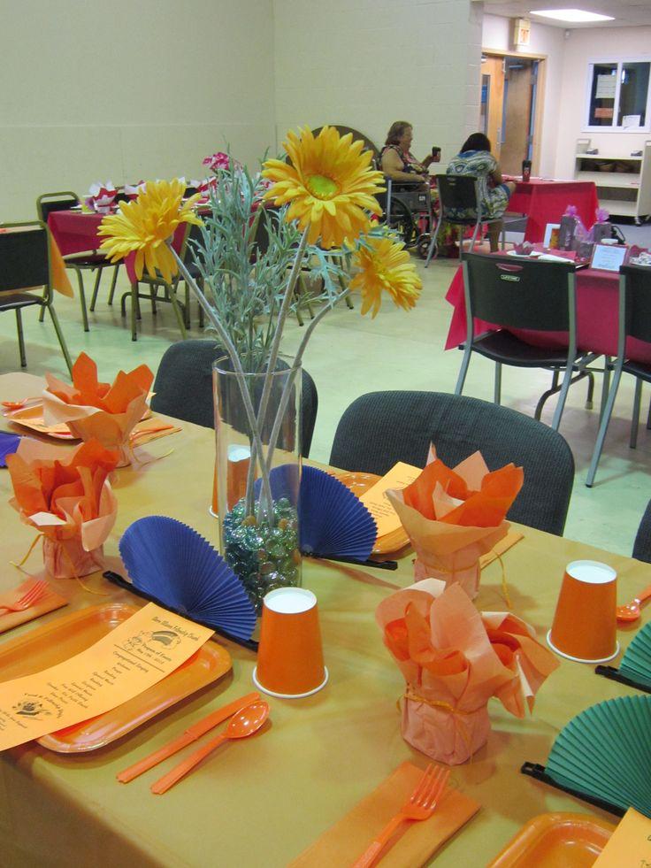 Orange table centerpiece rainbow tea pinterest for Orange centerpieces for tables