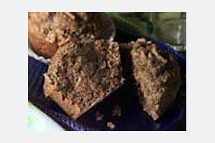 Applesauce replaces most of the fat in these moist muffins made with bran cereal and a touch of cinnamon. Serve them for breakfast or a snack.