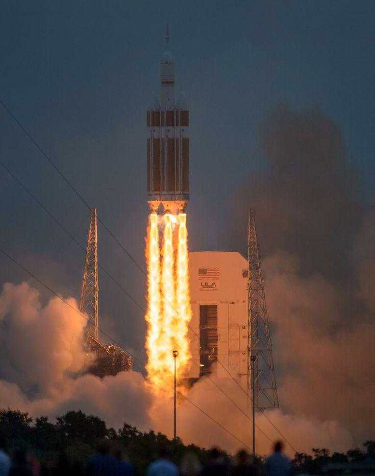 The United Launch Alliance Delta IV Heavy rocket, with NASA's Orion spacecraft mounted atop, lifts off from Cape Canaveral Air Force Station's Space Launch Complex 37 at at 7:05 a.m. EST, Friday, Dec. 5, 2014, in Florida. The Orion spacecraft will orbit Earth twice, reaching an altitude of approximately 3,600 miles above Earth before landing in the Pacific Ocean. No one is aboard Orion for this flight test, but the spacecraft is designed to allow us to journey to destinations never before…