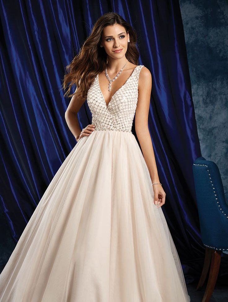 Wedding gown by Alfred Angelo Sapphire Bridal Collection.