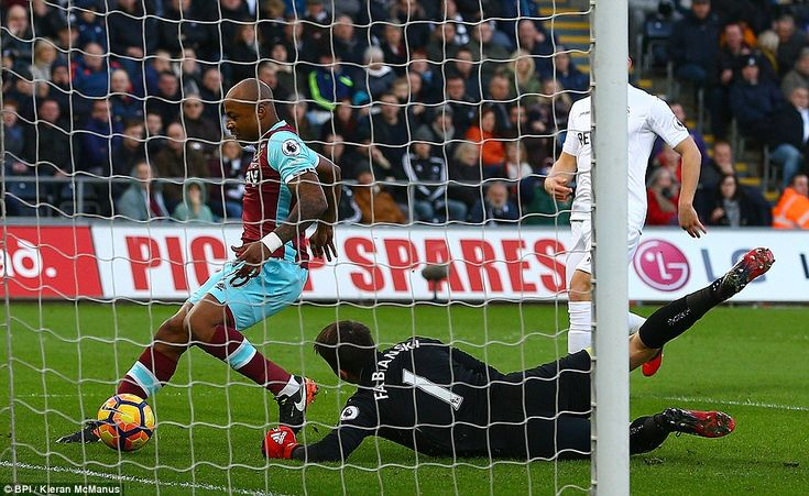 Andre Ayew reacts quickest to Andy Carroll's knockdown to put West Ham 1-0 ahead at the Liberty Stadium against Swansea
