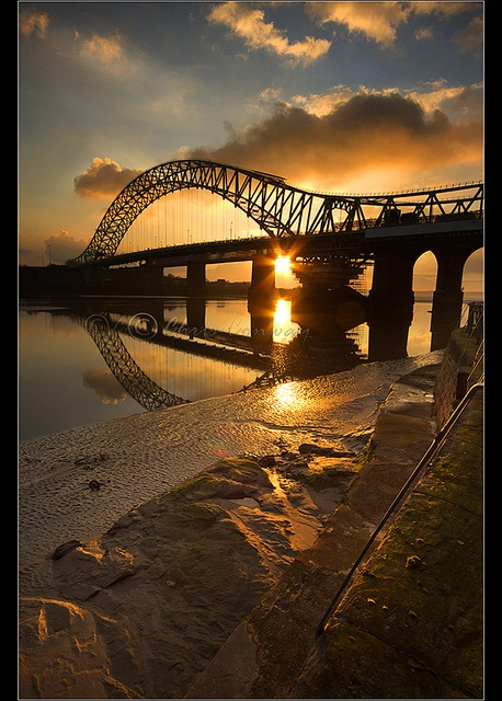 A portrait version of an earlier upload of Runcorn Bridge in Widnes / Golden Bridge portrait.... by Chrisconphoto, via Flickr