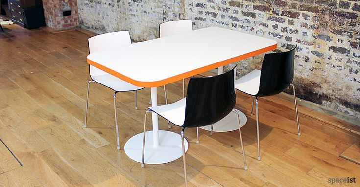 Edge four person orange rectangular canteen tables.