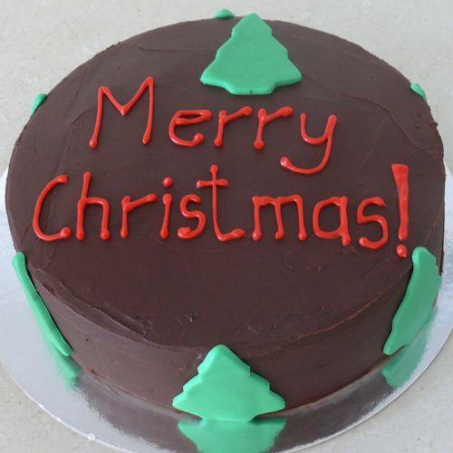 Gluten free Christmas cake covered in creamy ganache.