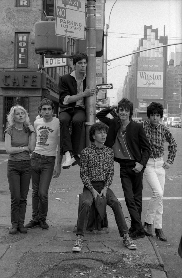 American new wave band Blondie on 8th Ave. & W. 30th Street (near Madison Square Garden & Penn Station), New York City, United States, 1977, photograph by Roberta Bailey. From left: Debbie Harry, Chris Stein, Jimmy Destri, Nigel Harrison, Frank Infante, and Clem Burke.