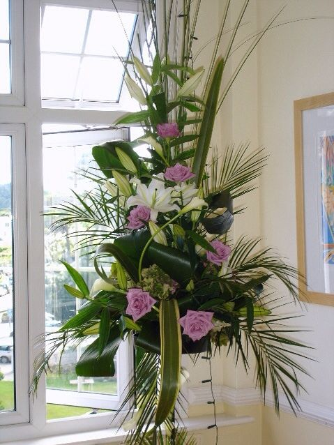 Tall pedestal by www.weddingflowersincornwall.co.uk