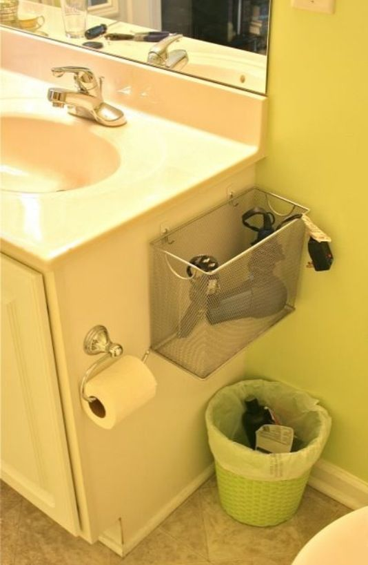command strips and a wire bin for bathroom storage!
