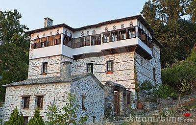 Stonemade Greek traditional tower house by Panagiotis Karapanagiotis, via Dreamstime