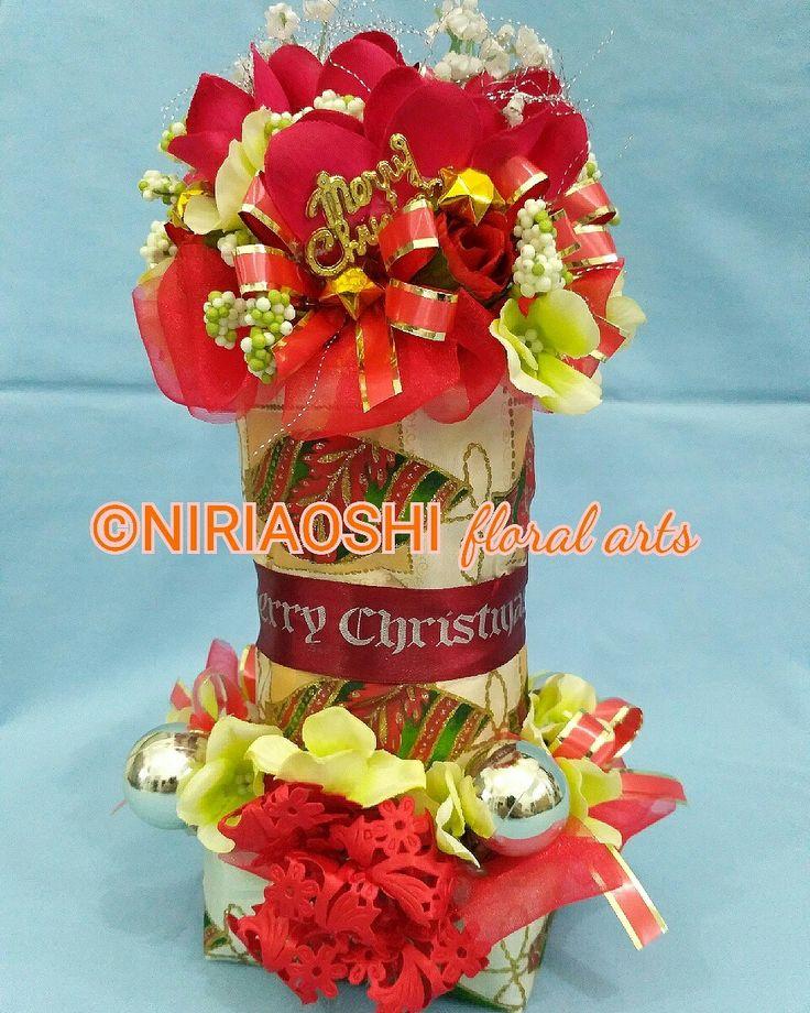 Christmas decoration from artificial flowers. https://www.instagram.com/p/BMi077eDmm_/  Masterpiece art from NIRIAOSHI Floral Arts. Height: 26cm. For Sell 🏷 idr 125k  #christmasdecorations #christmas2016 #dekorasinatal #bogorcraft #bogoronlineshop #bogorflower #creativeart #YCentrepreneur #bungabogor #rancamaya #bogordecoration #floralart