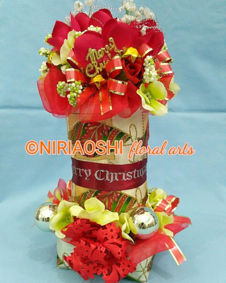 Christmas decoration from artificial flowers. https://www.instagram.com/p/BMi077eDmm_/  Masterpiece art from NIRIAOSHI Floral Arts. Height: 26cm. For Sell 🏷 idr 125k  #christmasdecorations #christmas2016 #dekorasinatal #bogorcraft #bogoronlineshop #bogorflower #creativeart #YCentrepreneur #bungabogor #rancamaya #bogordecoration #floralart