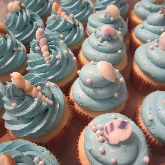 Beach Themed Wedding Cake and Cupcakes by Pink Apron Confections, via Flickr