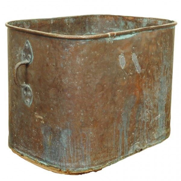 Copper Bathtub - the rectangular shaped top having rounded edges and two large handles, resting on a wooden frame