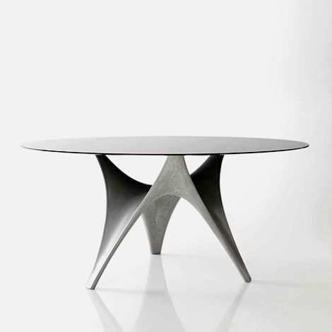 Arc table, designed by architects Foster + Partners for Italian design brand Molteni