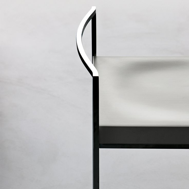 Chromed steel frame and wooden seat - playful combination of a decent chair